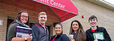 Muscatine Community College Student Center with students standing outside it