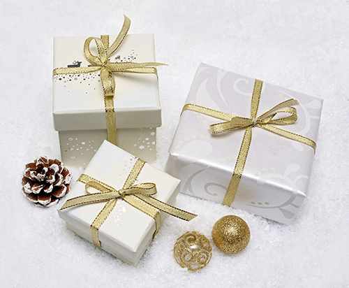 White giftcard boxes with gold bows