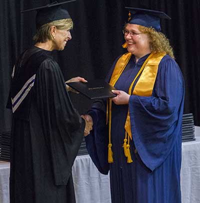 Adult student receiving degree