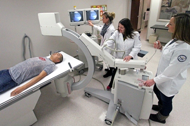 Radiology students practice taking x-rays in lab