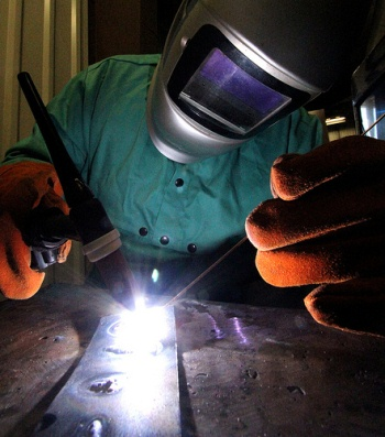 Student practicing welding in lab.